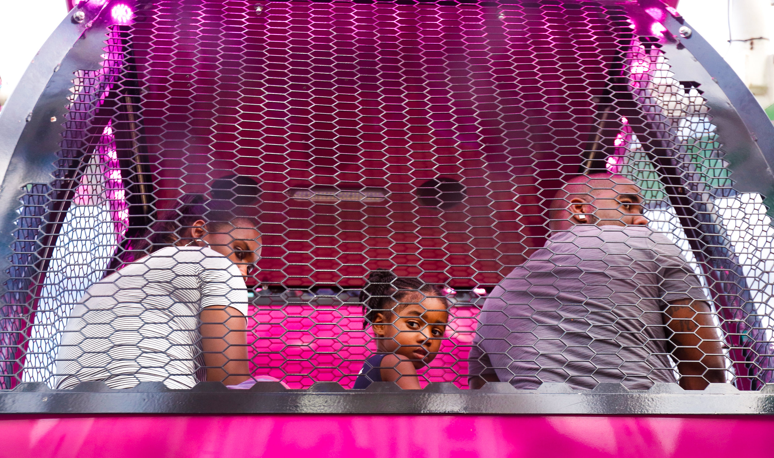 Peering back at the view, a family shares a sky bucket of a ferris wheel at the Georgia National Fair in Perry, Ga., on Saturday, Oct. 7, 2017.