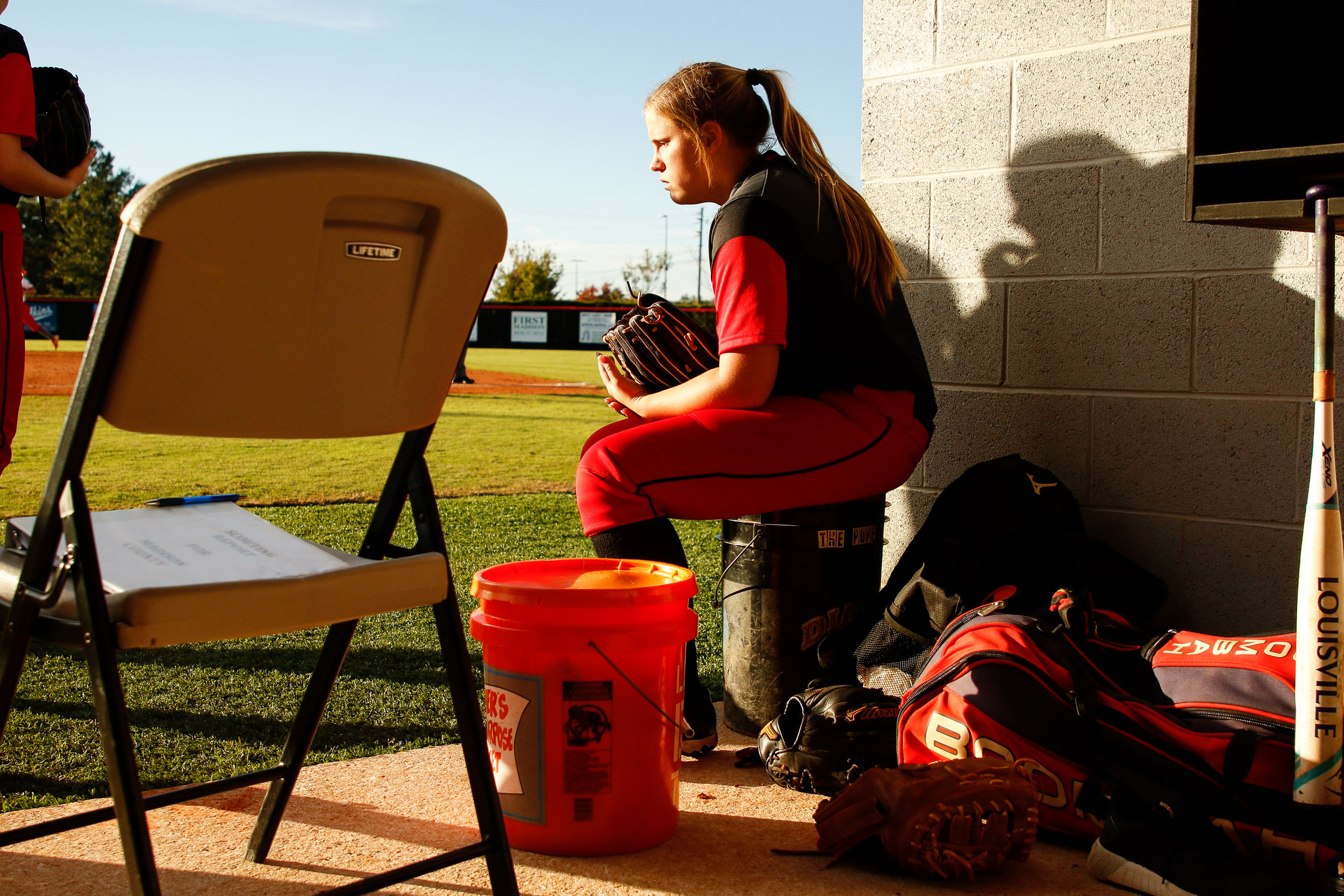 Flowery Branch Amanda Leblanc (36) takes a minute to herself between innings of game one of a second round class 4A playoff series between the Madison County Red Raiders and the Flowery Branch Lady Falcons in Danielsville, Ga., on Wednesday, Oct. 17, 2018. Flowery Branch fell 2-0 to the Raiders.