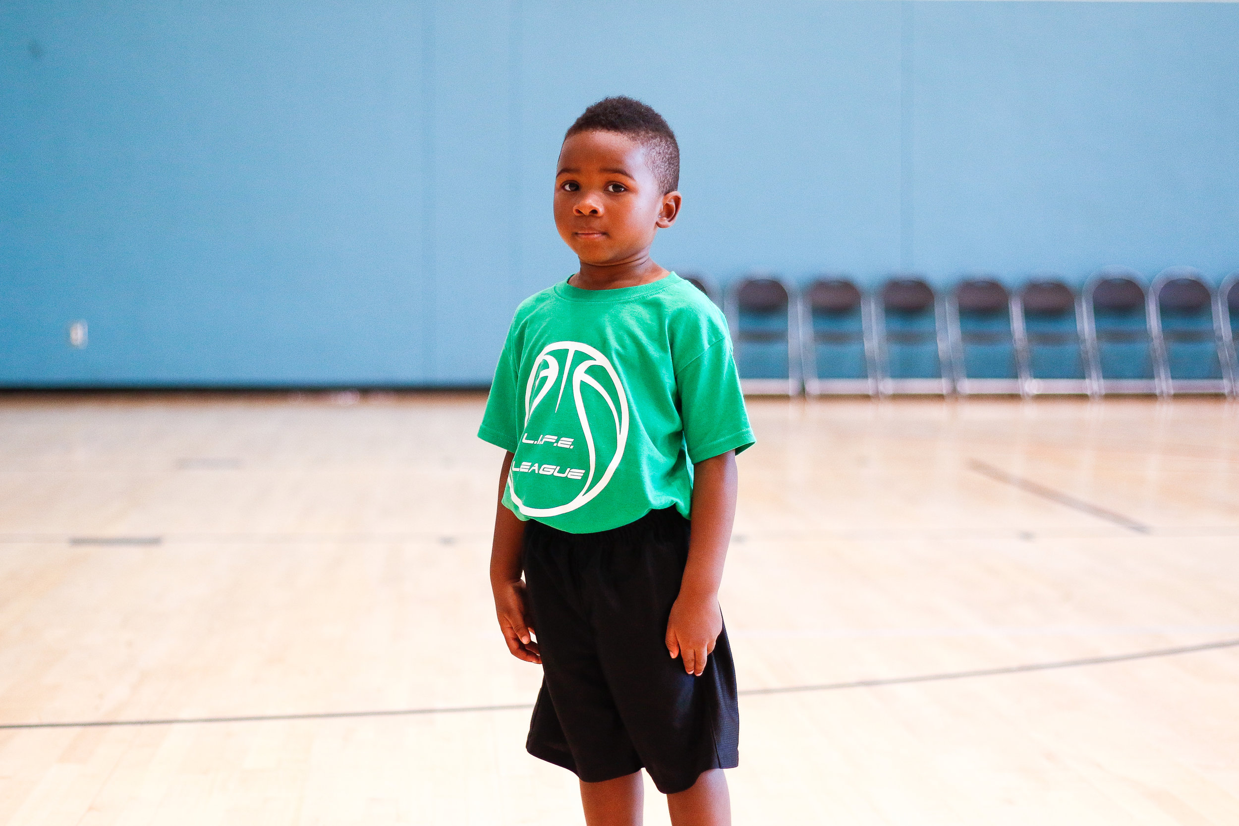 Camden Kendrick, 4, of Warner Robins pauses while crossing the gym at a Life League Basketball Camp in Ramsey Student Center on Friday, Jul. 13, 2018. Kendrick was one of 40 kids participating in Life League, a nonprofit that works to help young people develop life skills through athletics. According to his mother, Kendrick is reluctant to call the Lakers his favorite basketball team, but hopes to be Lebron James when he grows up.