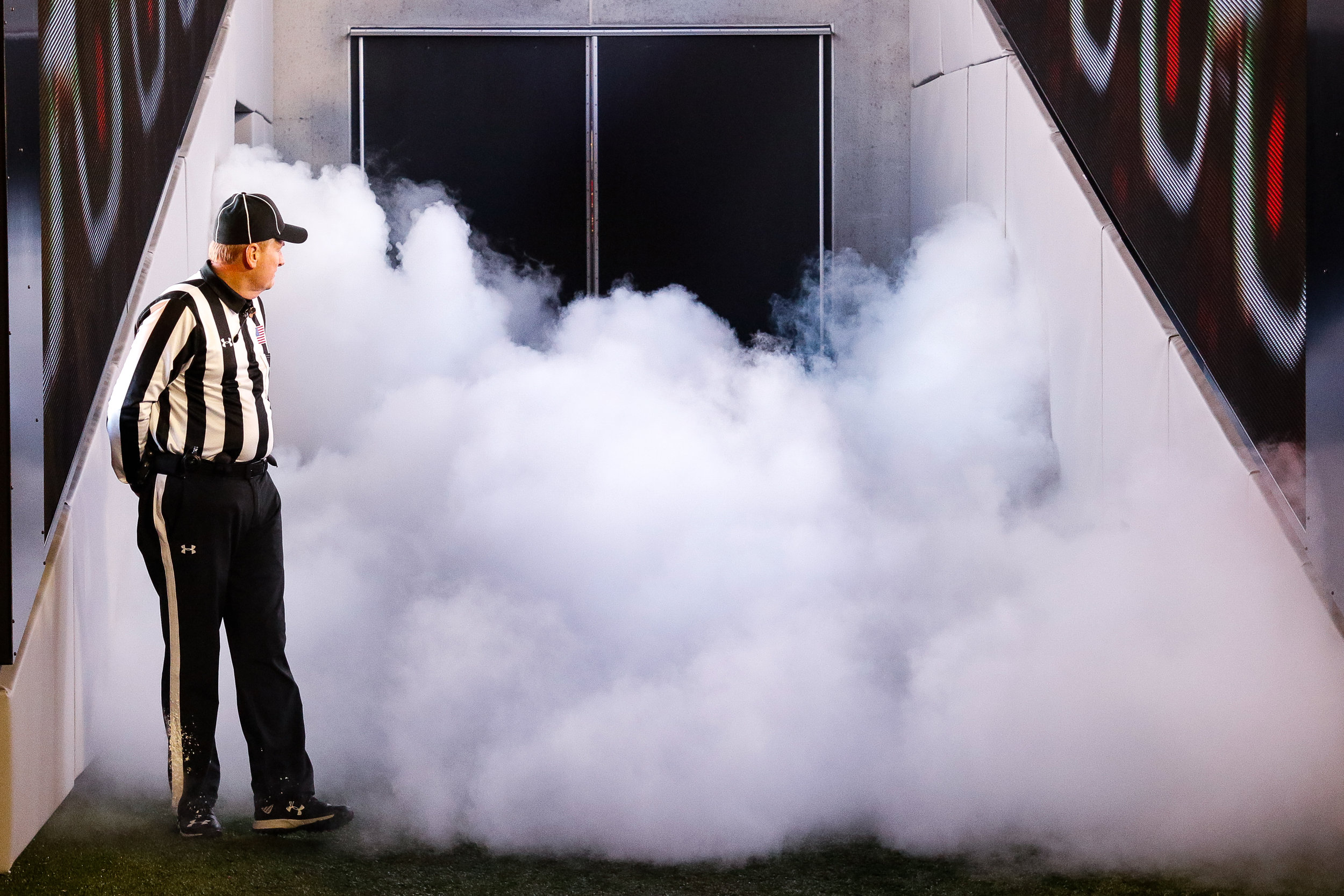 A referee double takes as smoke fills the tunnel, before the Georgia Bulldogs take the field for an NCAA football game between the University of Georgia and Auburn University in Sanford Stadium on Saturday, November 11, 2018.