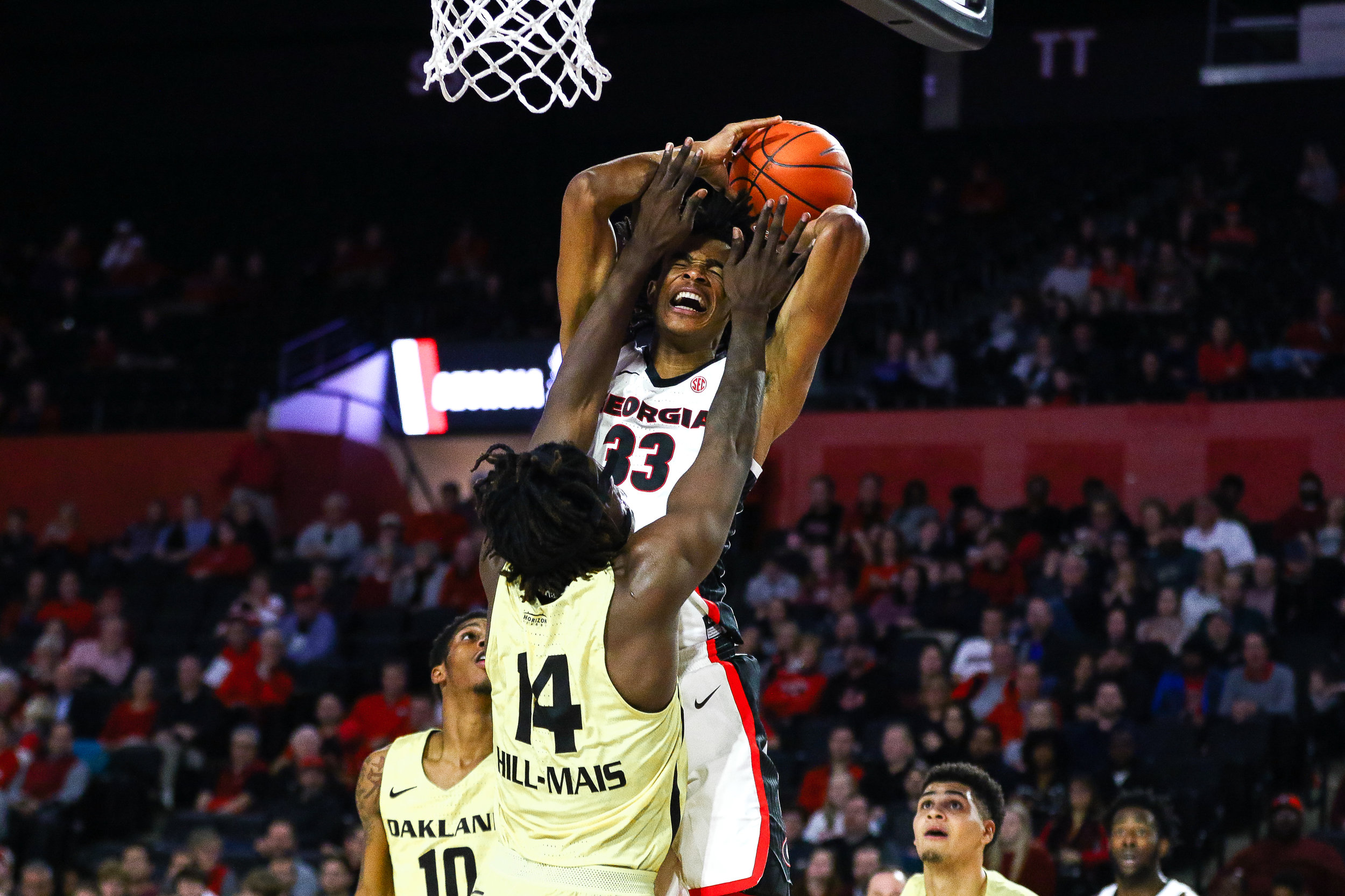 Georgia forward Nicolas Claxton (33) draws a foul during a men's basketball game between the University of Georgia and Oakland University in Stegeman Coliseum on Tuesday, December 18, 2018.