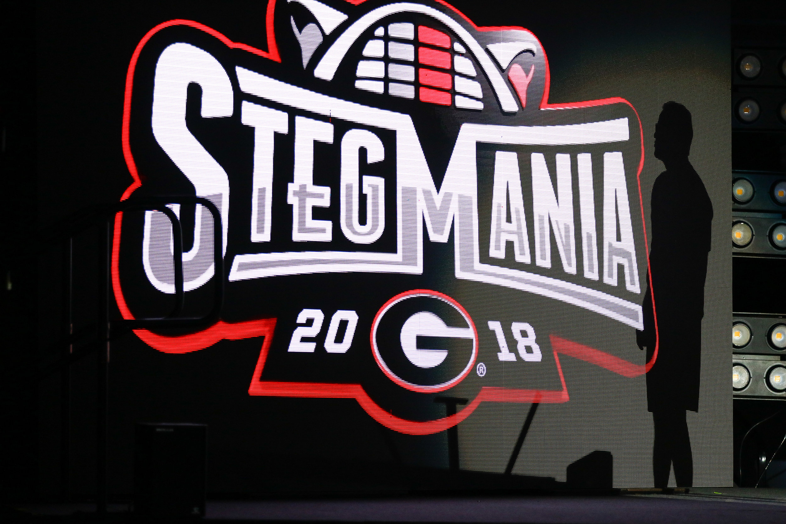 Georgia basketball head coach Tom Crean's silhouette is cast on a matrix board as he addresses fans for the first time at Stegemania in Stegeman Coliseum on Friday, October 5, 2018. Stegemania allowed both teams the opportunity to showcase their talents before the start of their seasons.