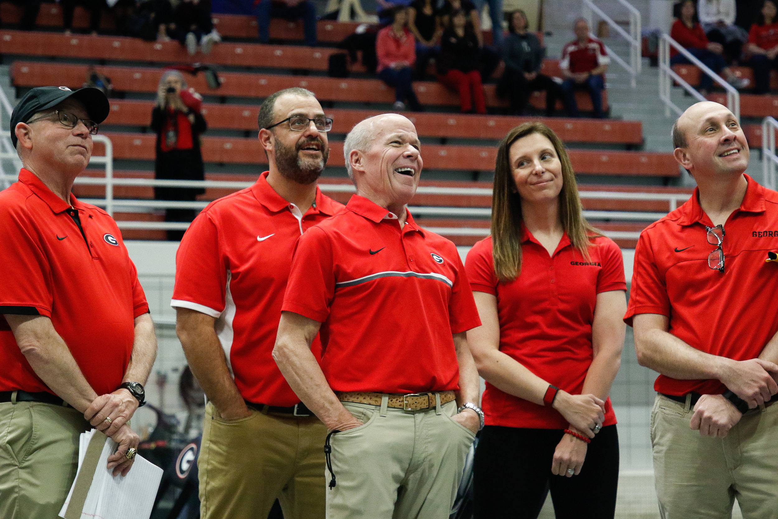 Georgia's associate head coach Stefanie Williams Moreno smiles while watching Georgia head coach Jack Bauerle react to a tribute video made for his 40 years of coaching on Saturday, Feb. 2, 2019. Moreno was among many of Bauerle's former swimmers that appeared in the video.