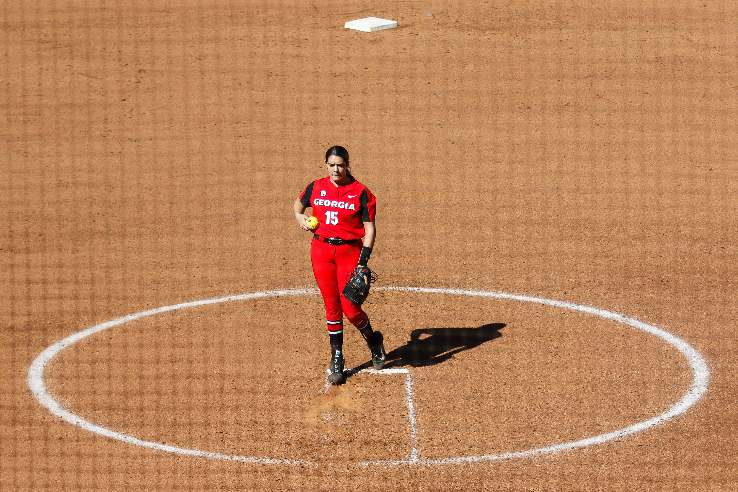 Georgia pitcher Alley Cutting (15) turns the ball over in her hand between pitches of a softball game against Belmont University in Athens, Ga., on Sunday, Feb. 24, 2019.