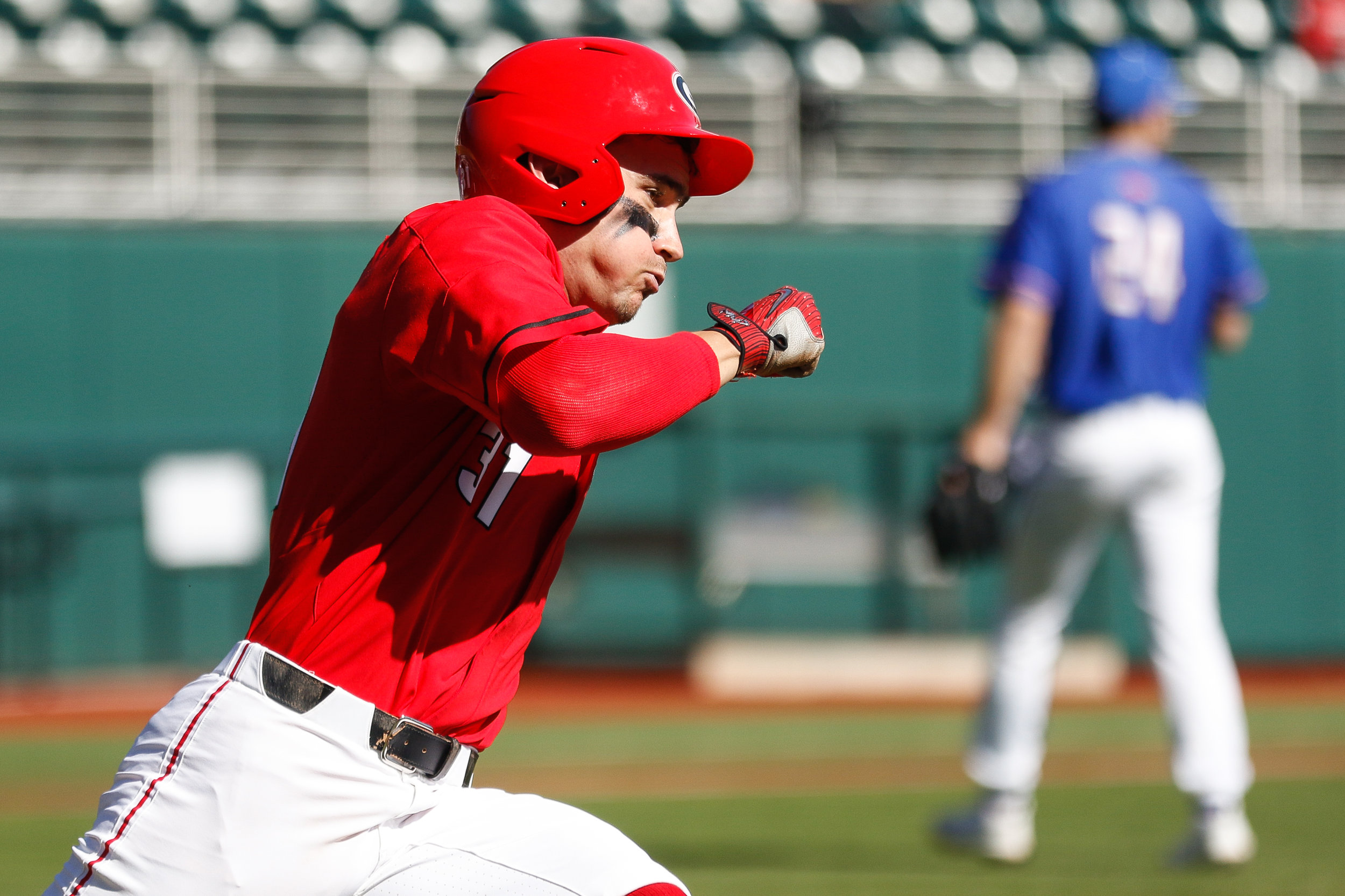 Georgia infielder Riley King (31) hustles to base during a baseball game between the University of Georgia and the University of Massachusetts Lowell in Athens, Ga., on Sunday, Feb. 24, 2019.