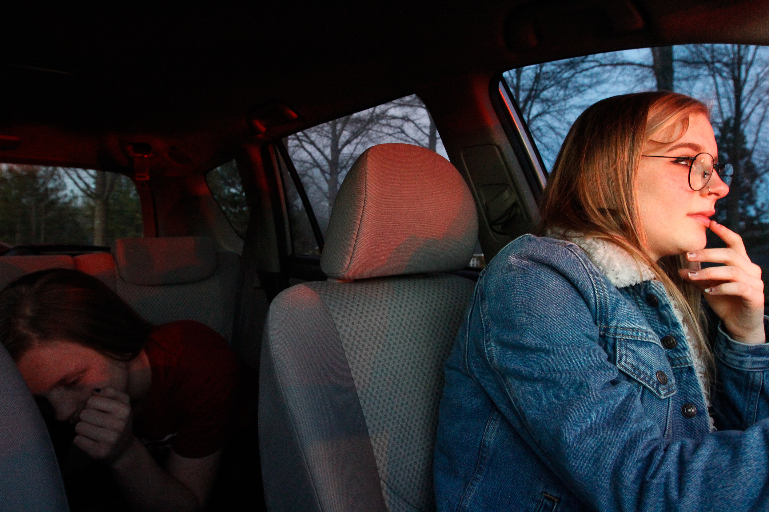 Ashlynn Brown and her sister, Izzy, drive home in silence from the grocery store on Sunday, Feb. 19, 2017.
