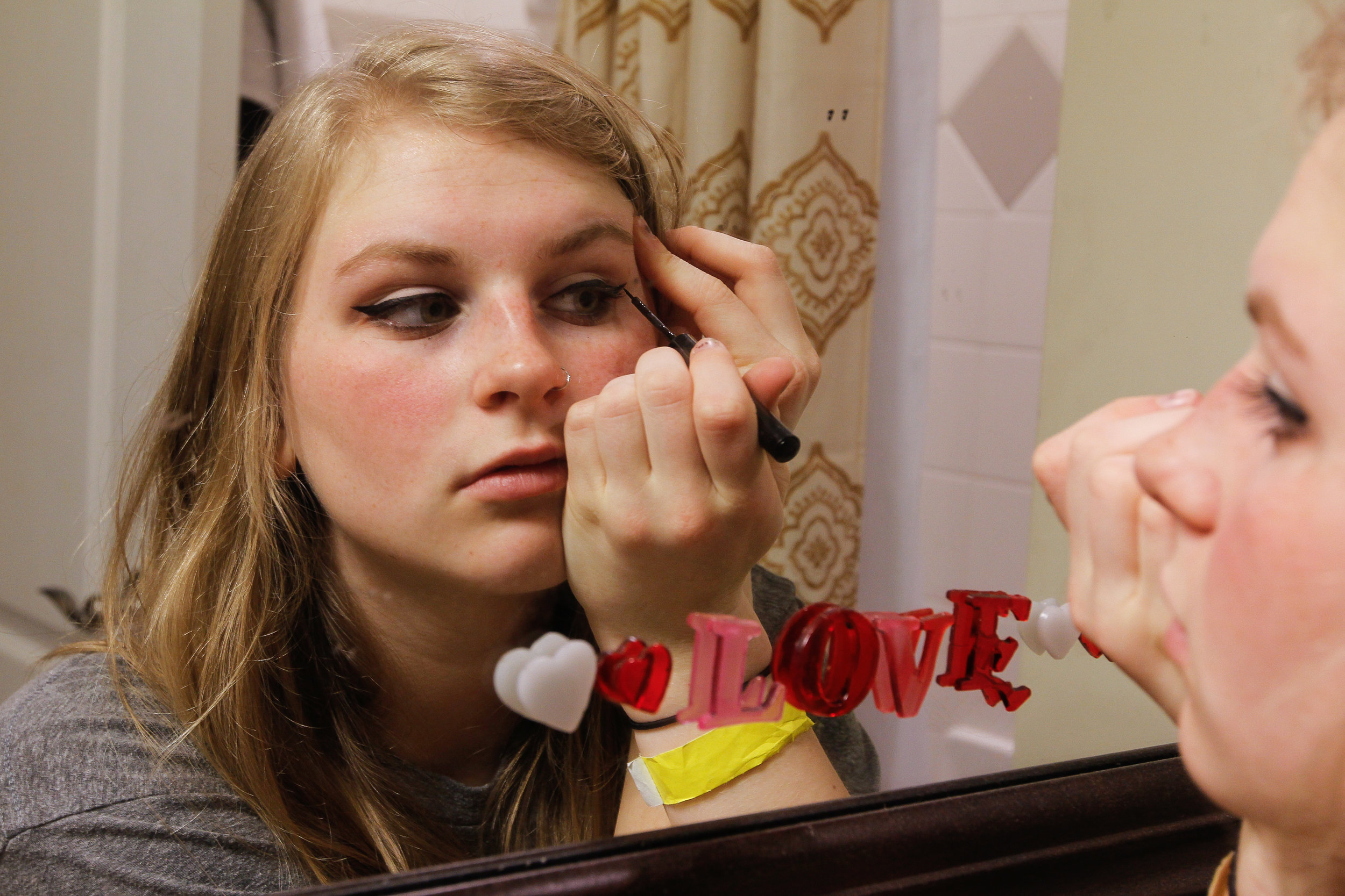 "Ashlynn Brown applies her famous winged eyeliner before leaving for the day in Woodstock, Ga., on Sunday, Feb. 19, 2017. Ashlynn refuses to leave her home without it. ""It makes me feel better,"" says Ashlynn."