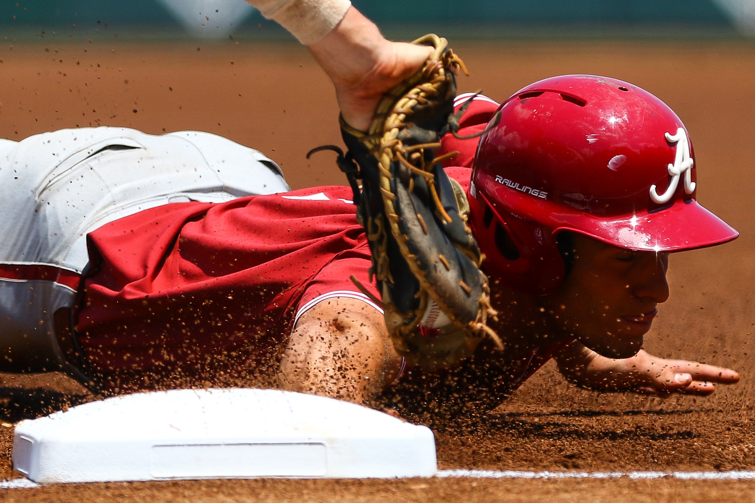 Alabama catcher Brett Auerbach (7) slides to safety during game three of a baseball series between Georgia and Alabama in Athens, Ga., on Saturday, May 18, 2019.