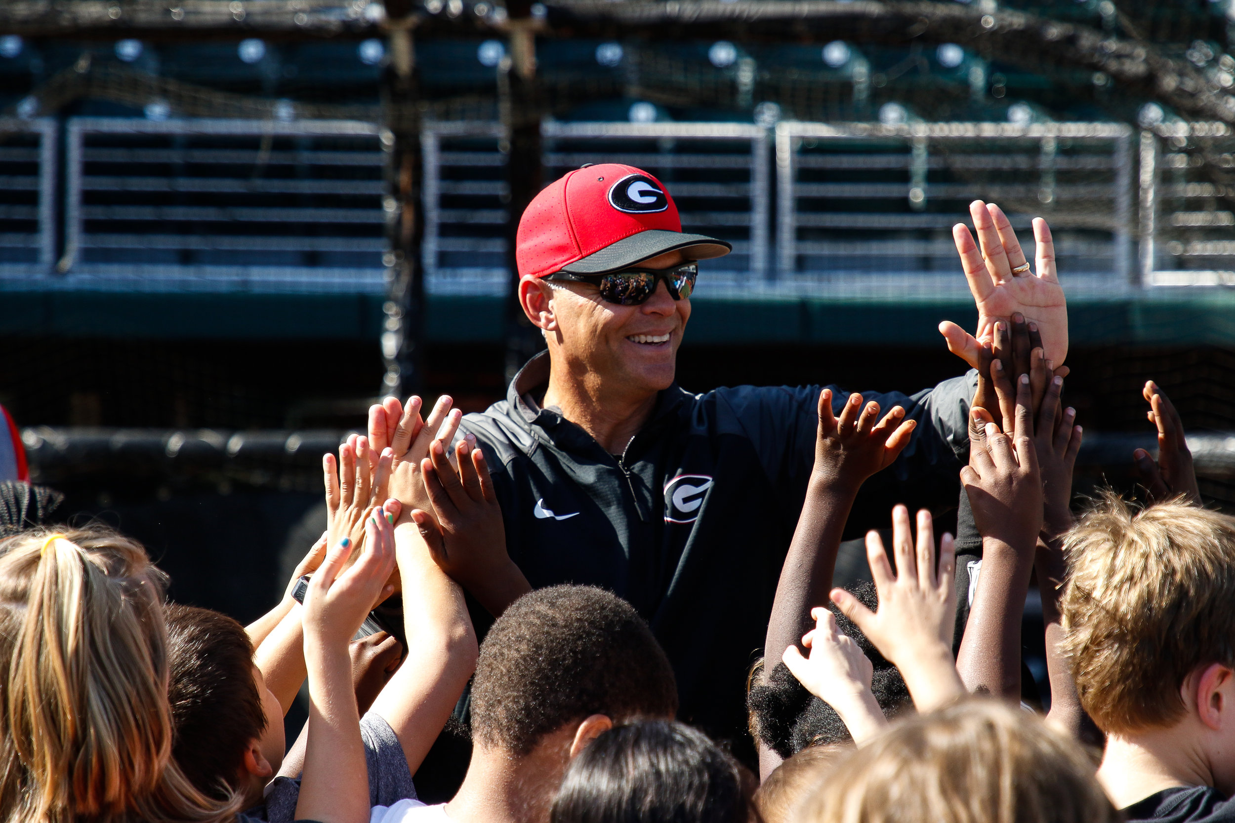 Georgia head coach Scott Stricklin high fives Barrow Elementary School students as the Georgia Baseball Halloween Practice comes to an end at Foley Field on Wednesday, October 31, 2018.