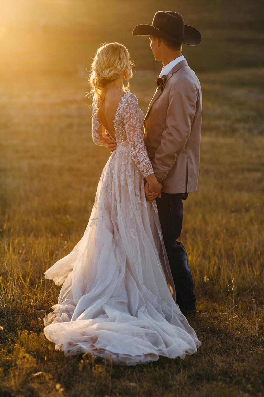 Couple at golden hour Elizabeth, Colorado farm wedding.