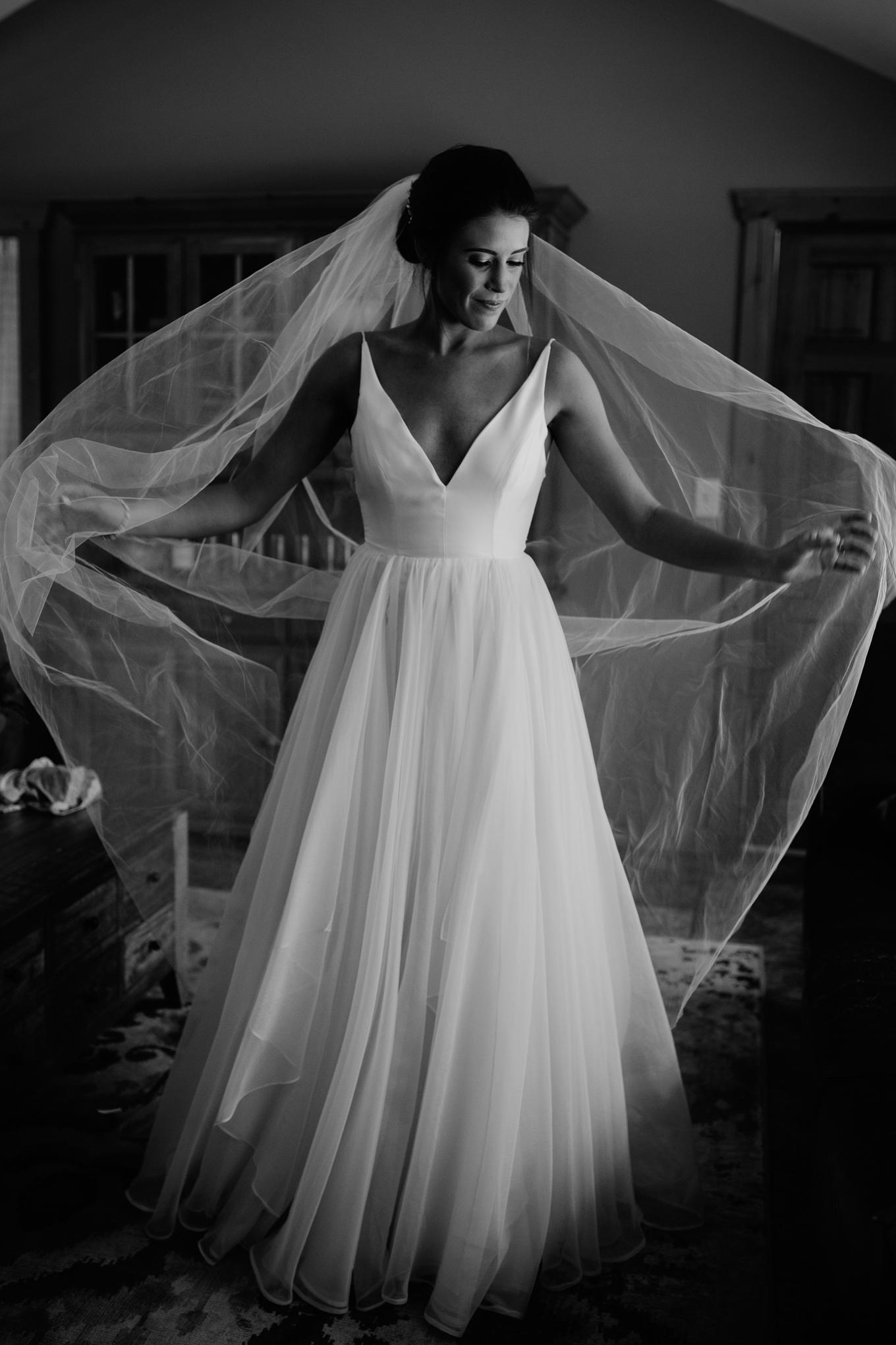 River Bend, Colorado wedding portrait of bride getting ready.