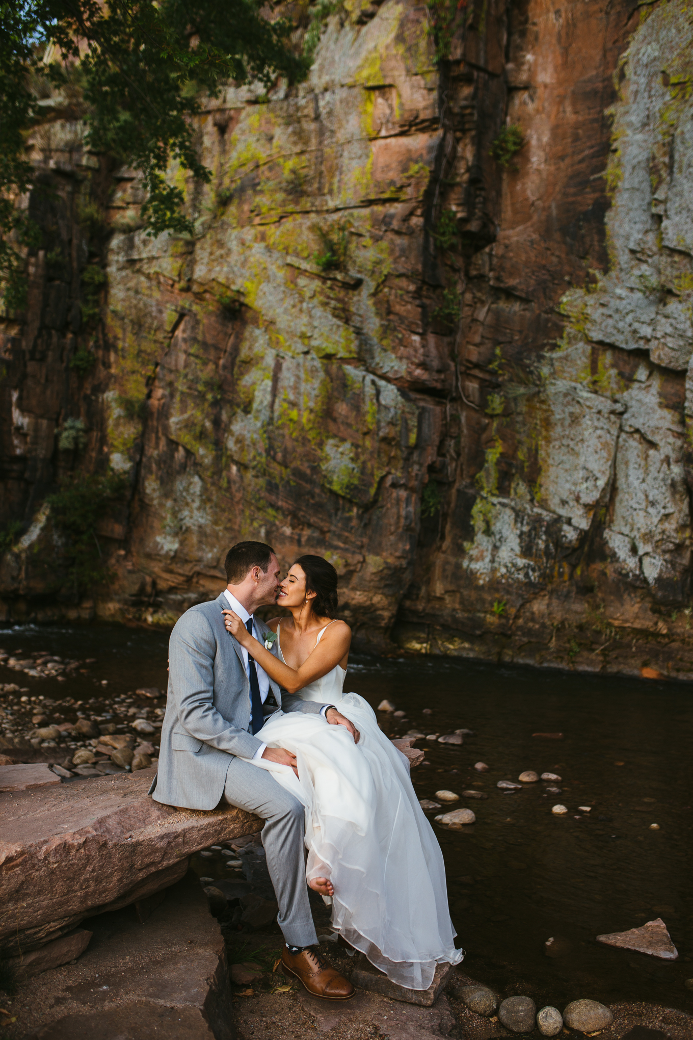 River Bend, Lyons, Colorado wedding couple by river.