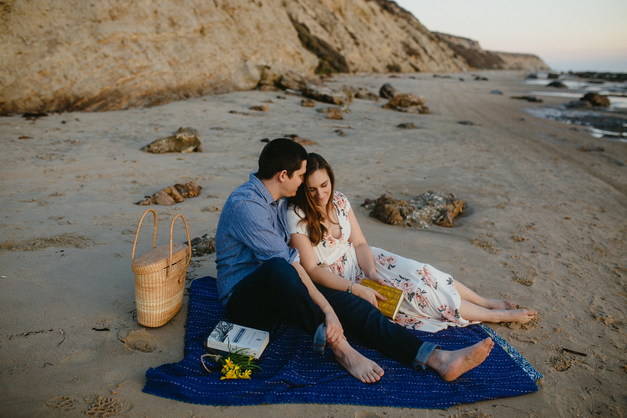 Engaged couple on the sands of Crystal Cove State Park.