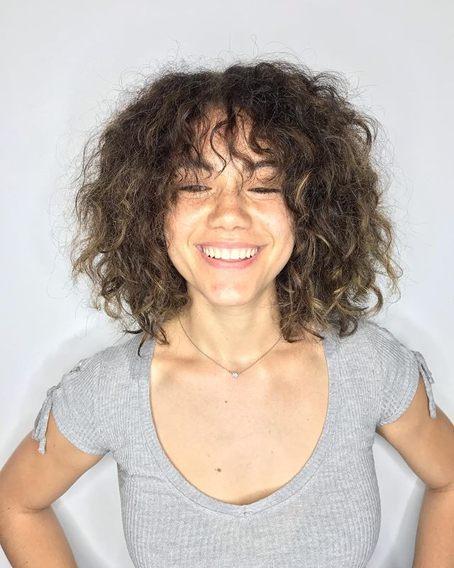 Adding layers plus subtle painted highlights transformed this babe's look!  What a babe! 😍 I really enjoyed this project.  #discohair #hairgoals #curlyhair #curlyhairstyles :: :: :: :: :: :: #brooklyn #brooklyncolorist #brooklynstylist #williamsburg #newyorkcity #btcpics #behindthechair #hairbrained #wellahair #wellaproducts #balayage #balayageombre #balayagehighlights #highlights #hairporn #paintedhair #handpaint