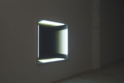 Iván Navarro  [b. 1972, Santiago Chile – lives and works in New York]  Large Wall Hole  (provisional title), 2004, Fluorescent tubes,  painted metal boxes, plastic, 40 in. X 40 in.