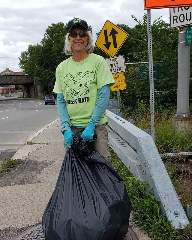 Cleaning up around the W. Adams bridge.