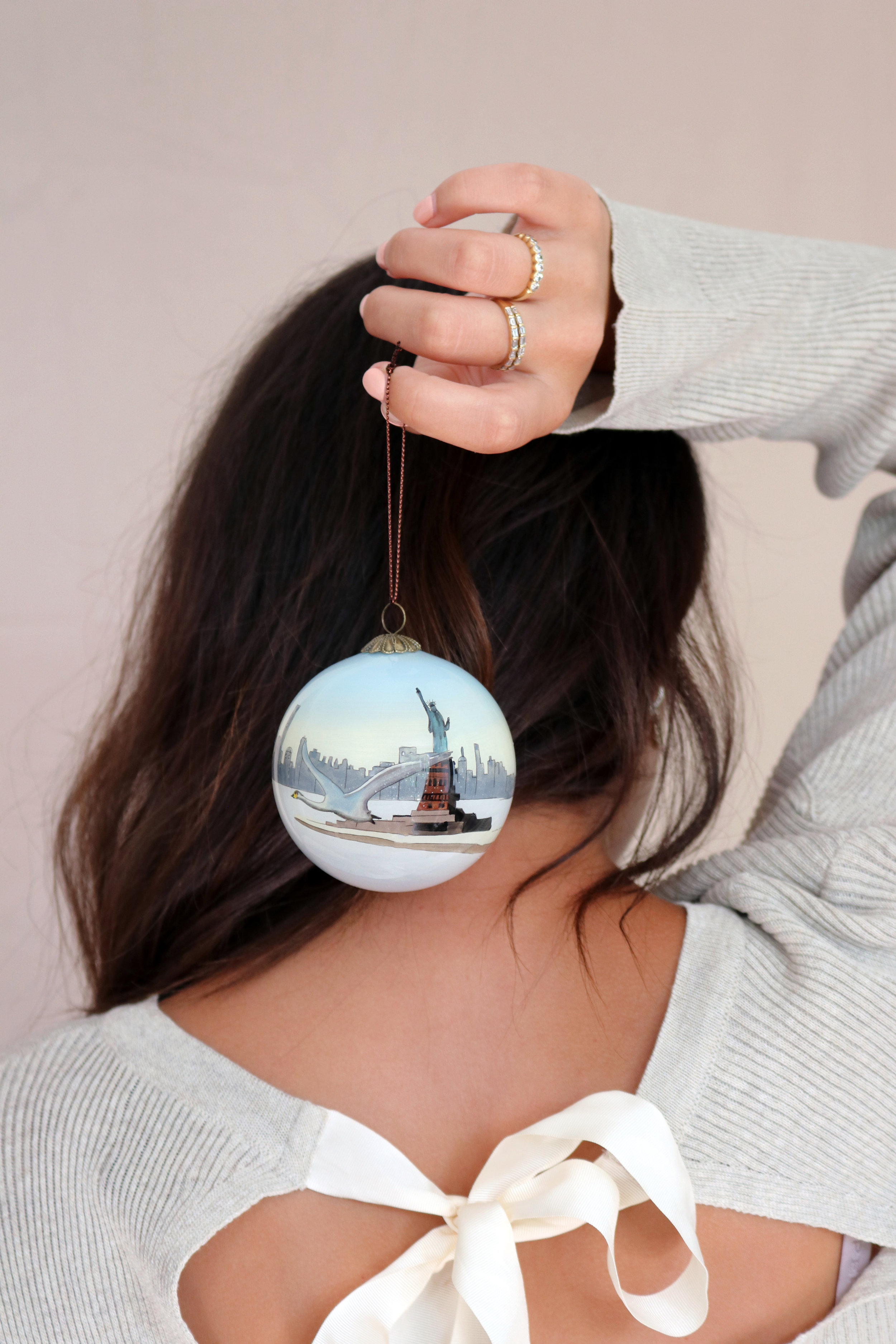 """<p><strong>Until Next Time, New York</strong>Hand painted glass bauble<br>£20<a href=""""/area-of-your-site"""">Shop</a></p>"""