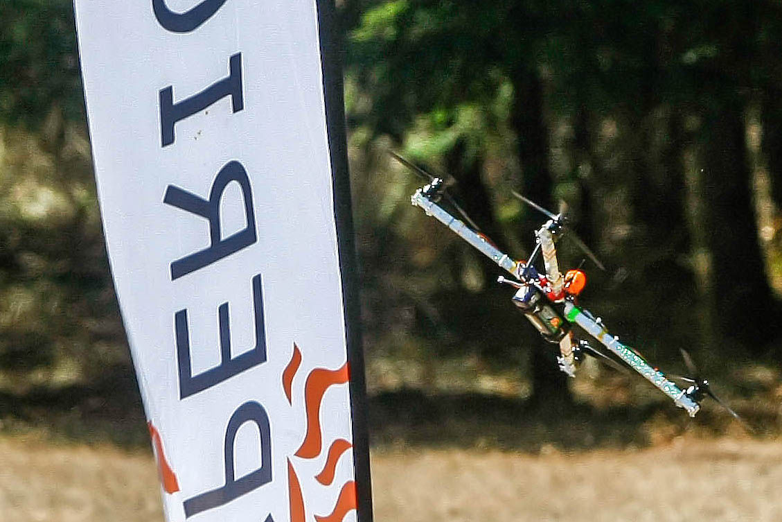 An X Class drone zips past a flag durring a practice race at the 2017 West Coast Throwdown held Saturday at Whistler's Park (Mike Henneke/News-Review photos)