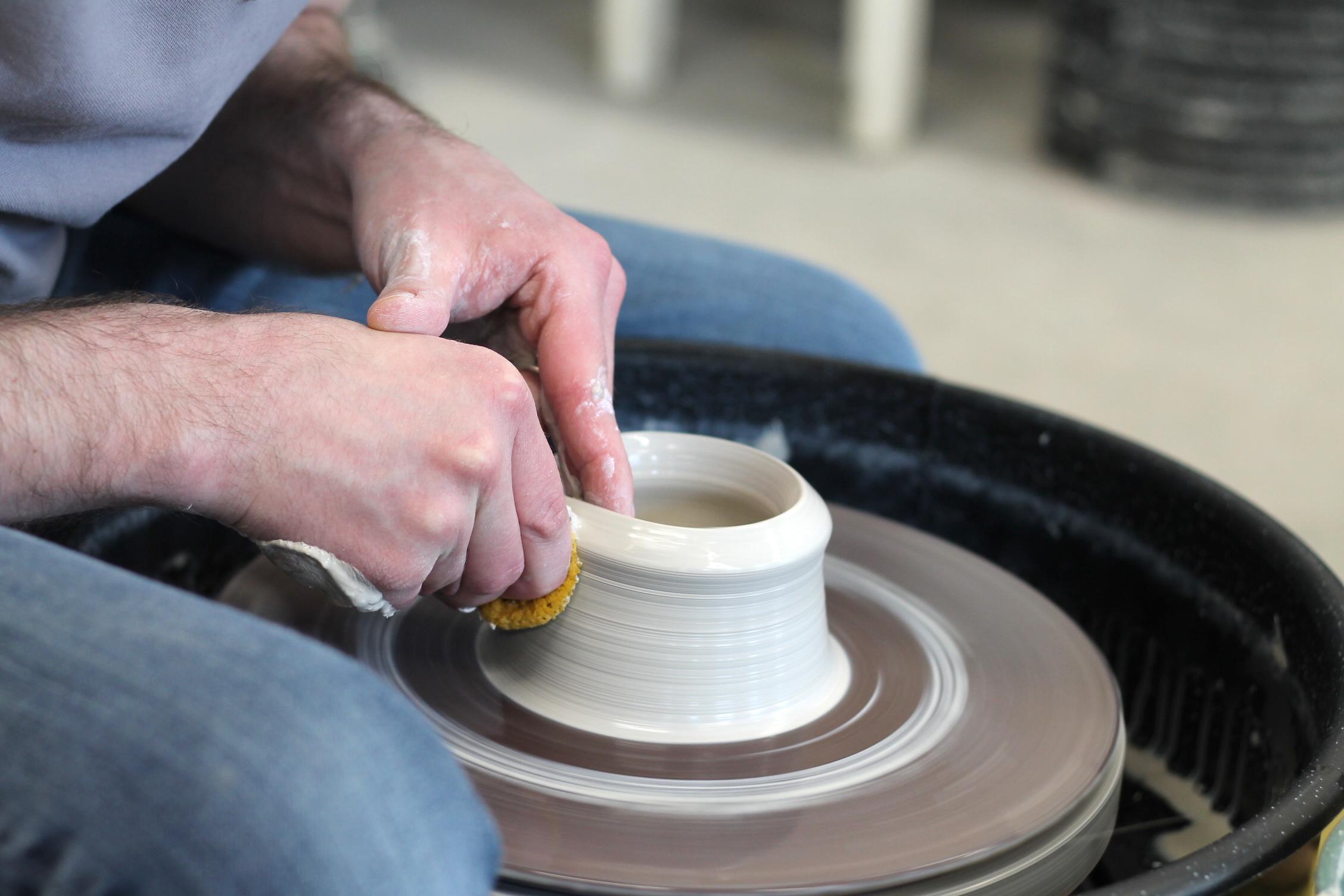 Art Lab - Pottery jordan at the wheel.JPG