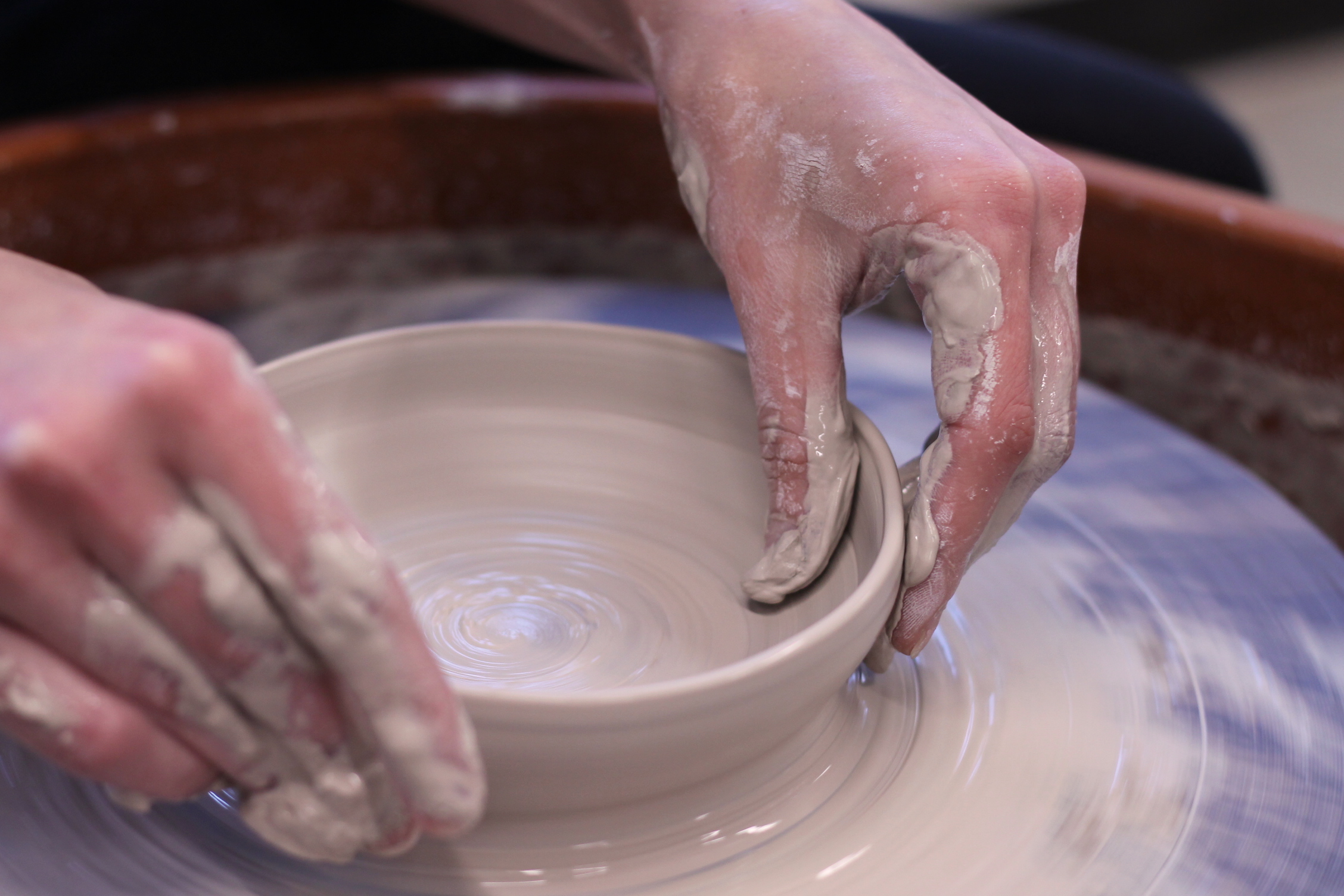 Pottery - hands on wheel.JPG