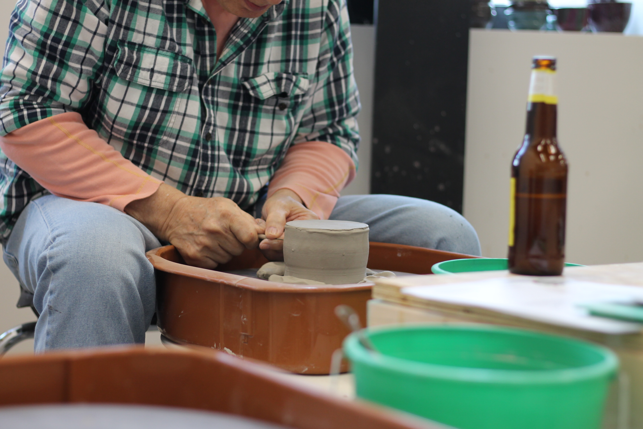 pottery student on wheel.JPG