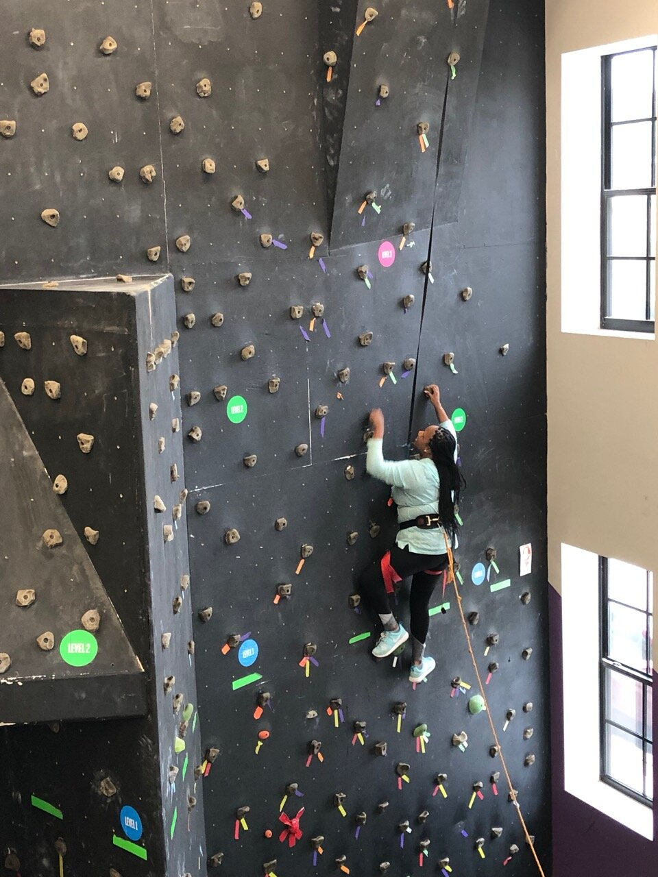 Harnessed climbing helps participants reach new heights