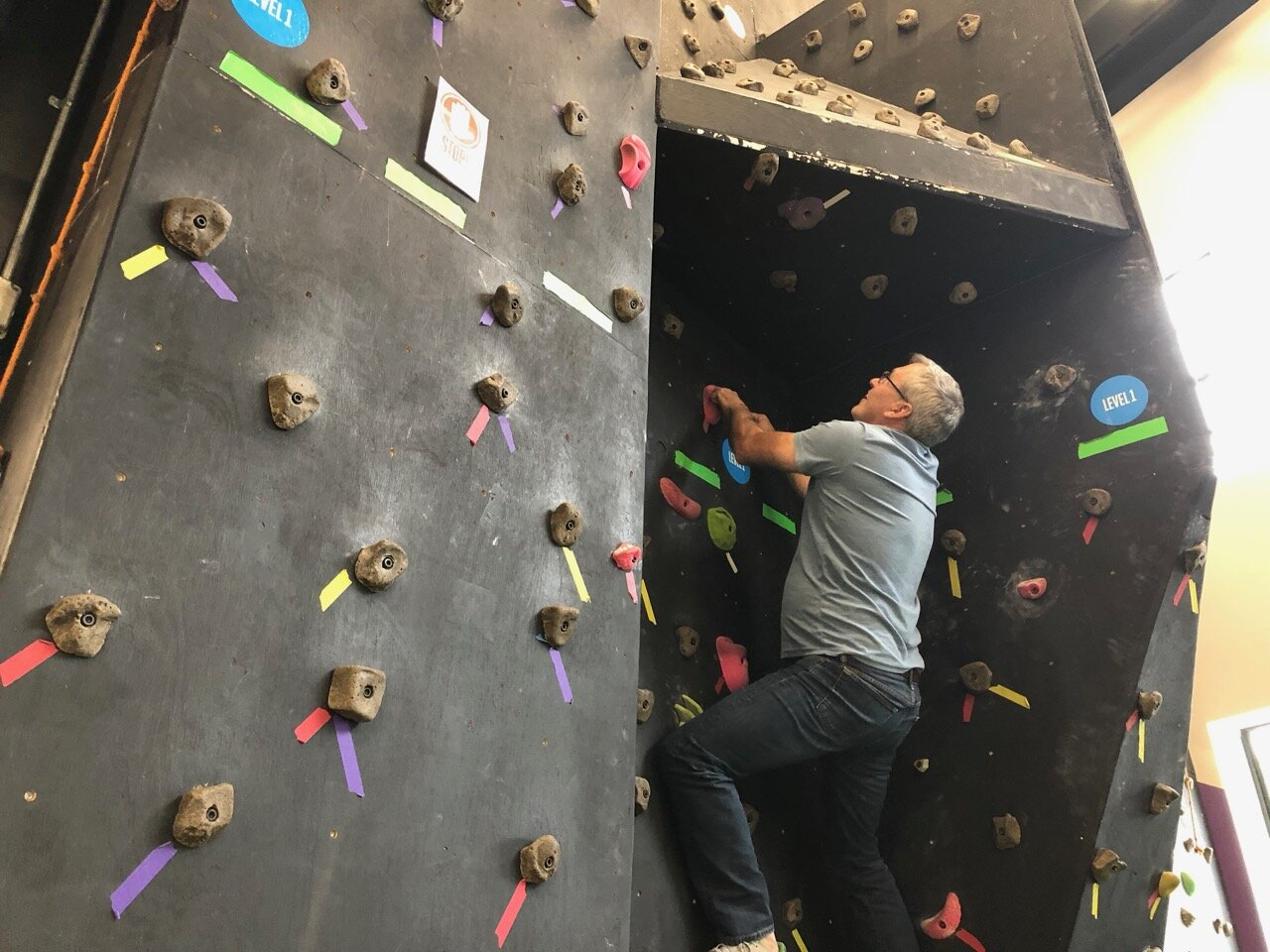 "Meeting participants get hands-on with ""in the moment"" problem solving on the rock wall"