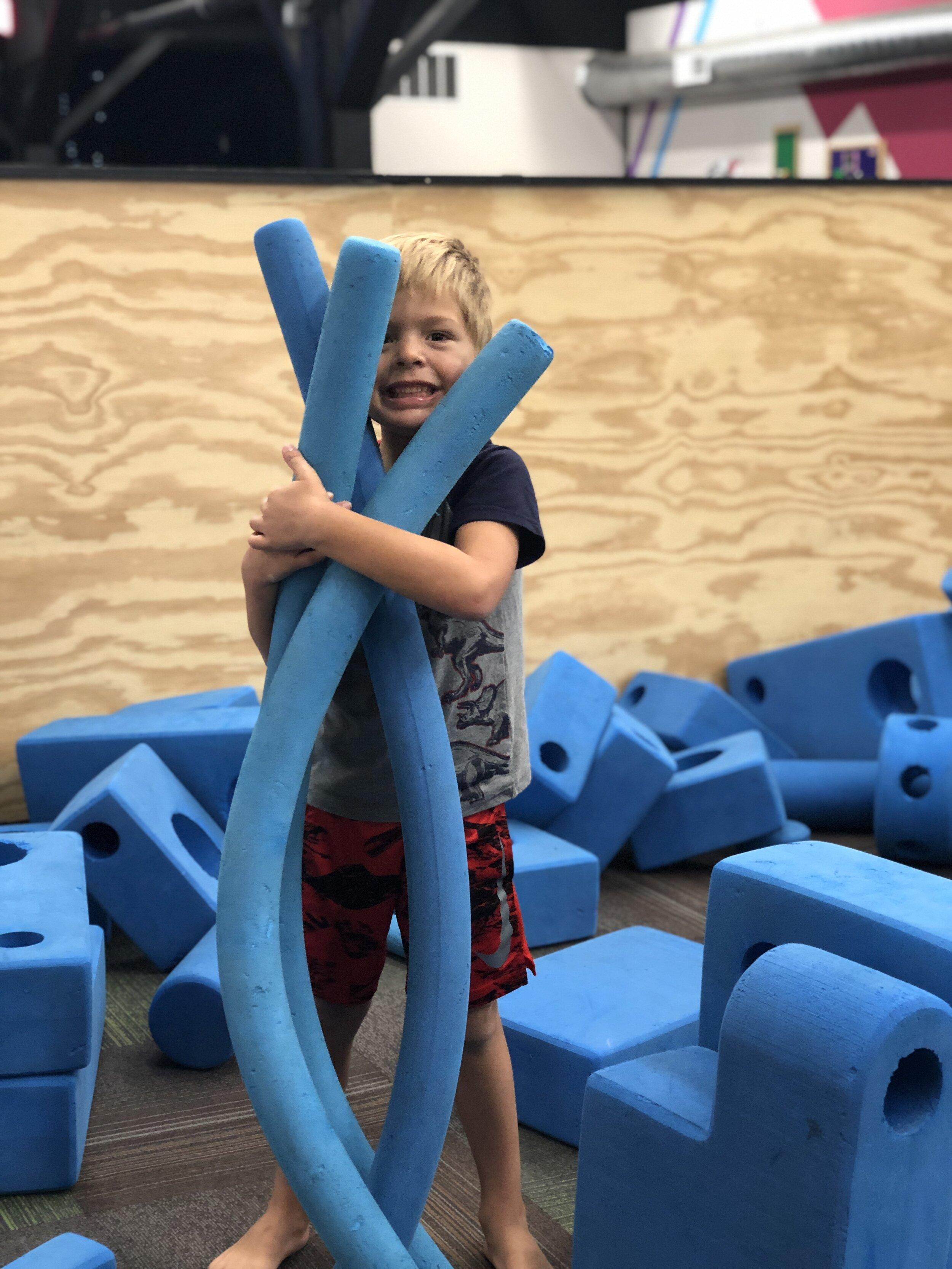 Camden enjoying the giant foam blocks