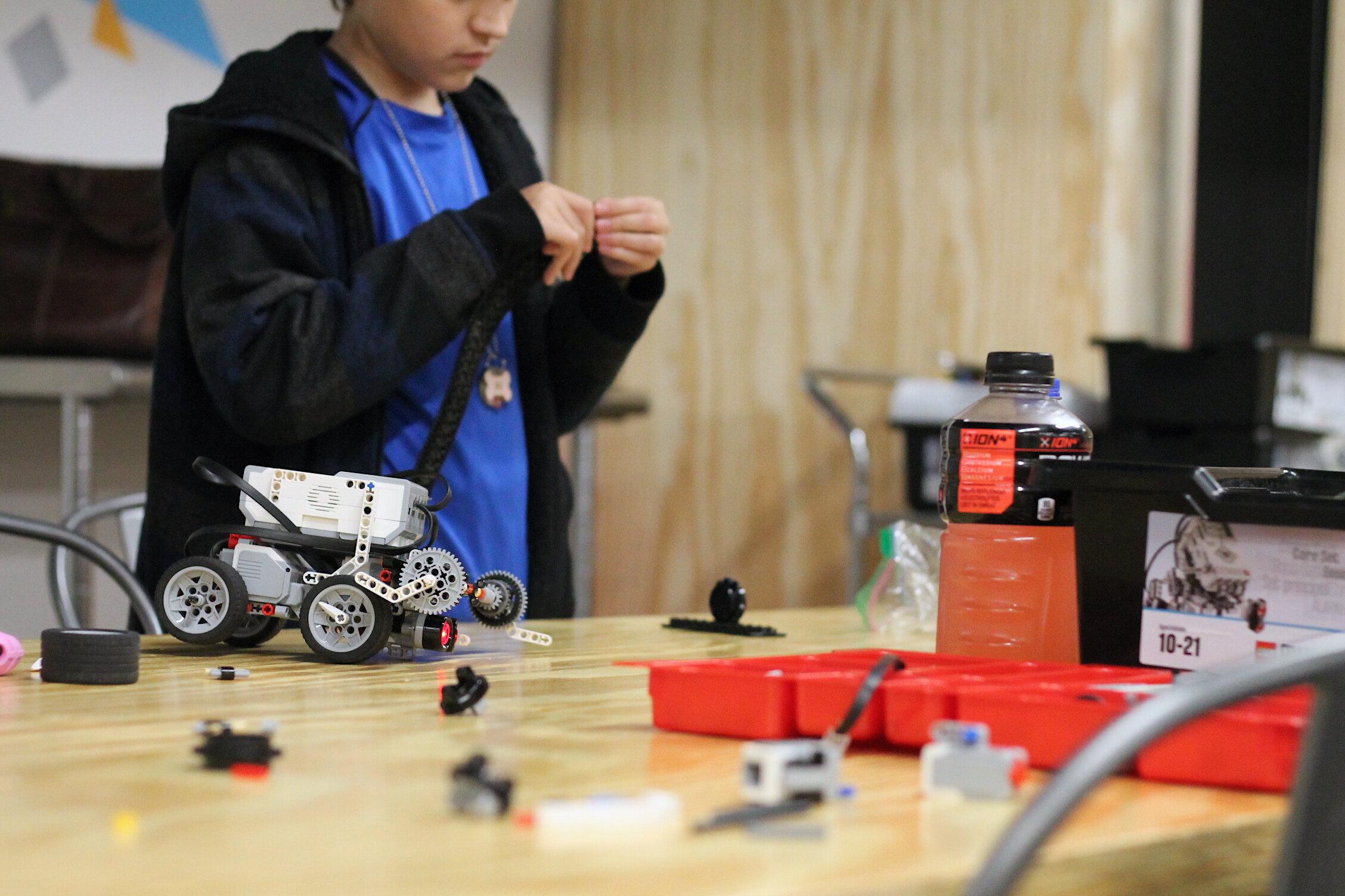 Traveling Lab-Robotics Camp, kid building robot.JPG