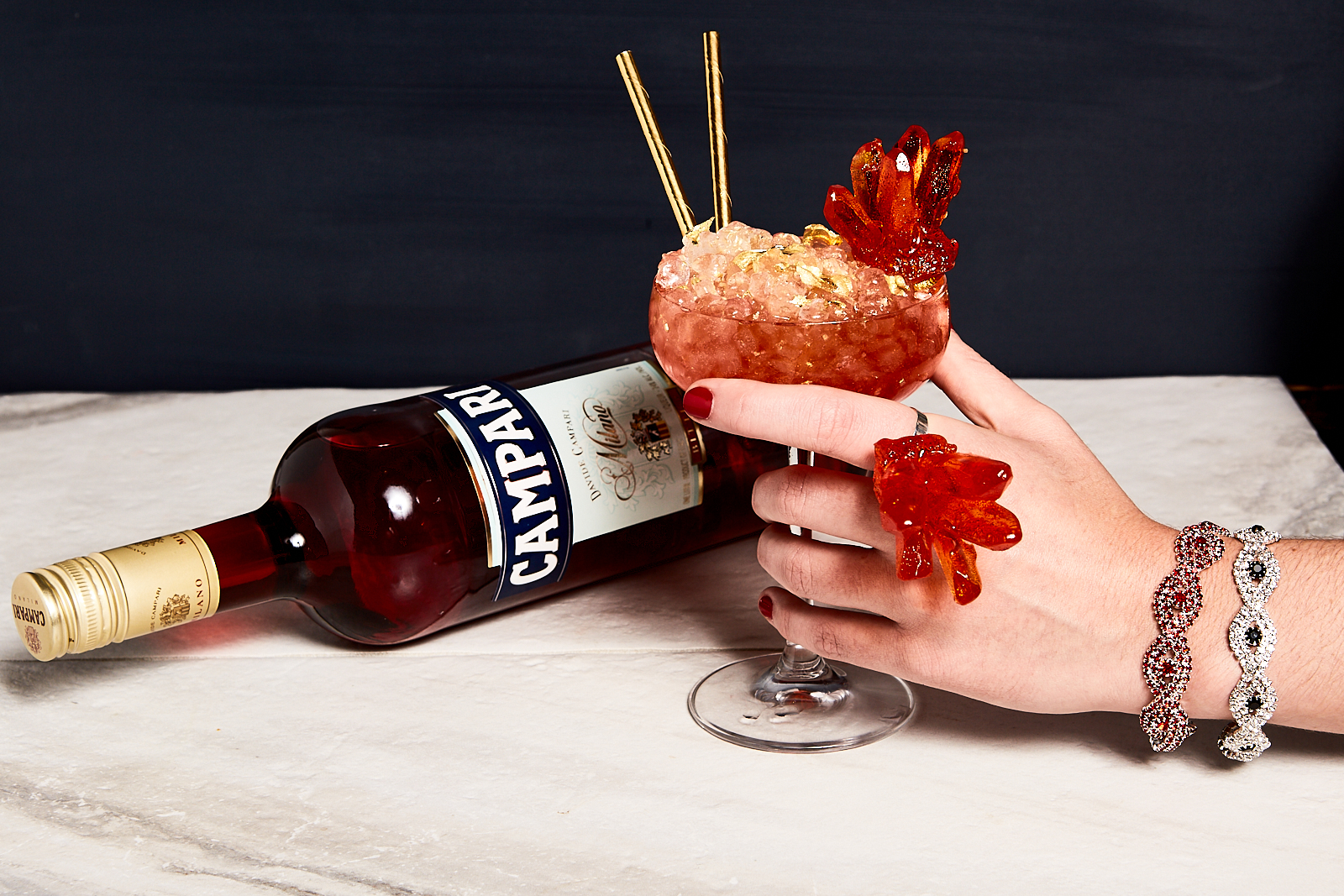 Cocktail Bling_w bottle and hand.jpg