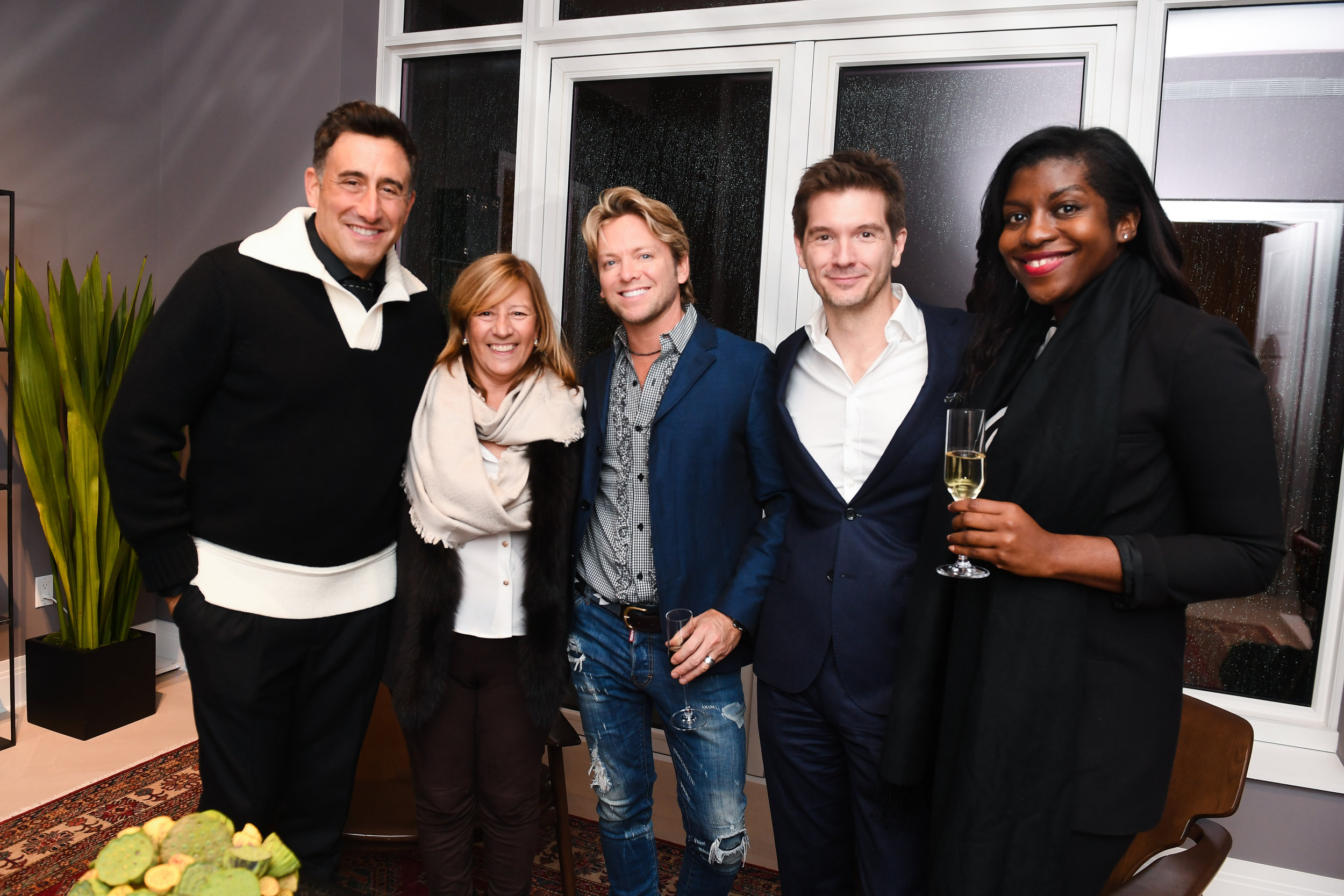Scott Stewart and Maria Pashby of The Corcoran Group, author Bruce Littlefield, and David Ayers and Nicole Christie of The Corcoran Group at the Louis Vuitton partnership at  30 Park Place Four Seasons Private Residences
