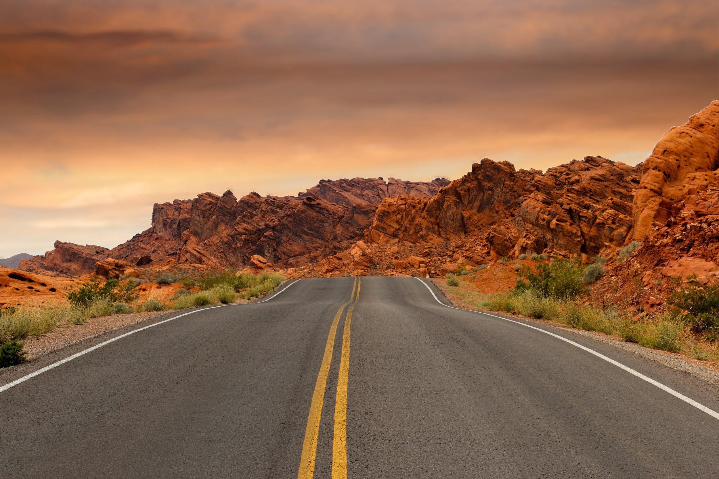 road-mountains-sunset-path-163848.jpeg