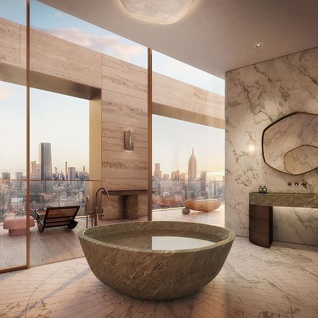 The ethereal master bath at @theXInyc West Tower Penthouse features a custom sandblasted verde caldia floor, a carved verde scuro tub, and bronze vanities with marble tops designed by #AD100 French interior architect @pierre.yovanovitch.  Situated in vibrant #WestChelsea, #TheXI, designed by @BjarkeIngels and developed by @HFZcapitalgroup, spans a full city block nestled between the #HudsonRiver and the #High Line. The unique twisting towers are accented by a travertine façade and oversized windows detailed in bronze, lending timeless beauty to both buildings with no two-floor plans precisely alike.  Residents of both towers will avail themselves of 18,000 square feet of sun-filled, private residential amenity spaces curated and managed ‎by @sixsenseshotelsresortsspas, including a 75-foot pool, fitness center, and spa; extensive entertaining lounges and wine cellar; and both teen and children's rooms.  #Repost from @douglaselliman with @regram.app