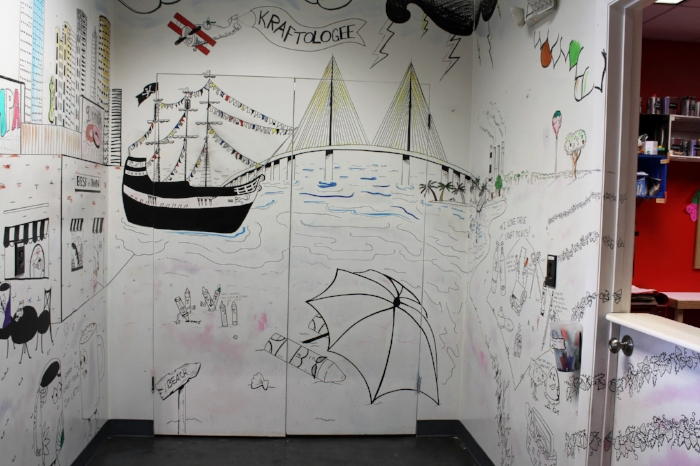 Kids can color on the walls while they are waiting to get checked into a Creativity Lab