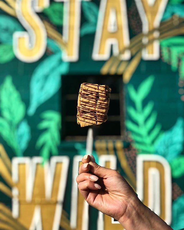 So much local goodness in one photo 💕✨ .⁣⠀ Tasty treat from @kilwindsstpete⁣⠀ Mural by @leogomezstudio⁣⠀ Located at @wildrootsstpete . What's your favorite place for a tasty treat? We want to know! . 📷: @sainteatersburg
