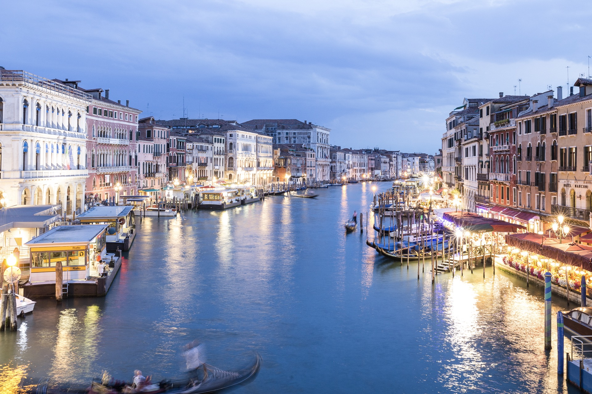 A view from on top of the Rialto Bridge during blue hour