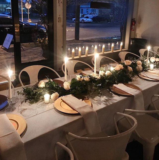 A gorgeous, candlelit setup for an intimate rehearsal dinner in the Studio, complete with fresh flowers and cool Mississippi evening breezes. | #ArdorVenue #GatherAtArdor