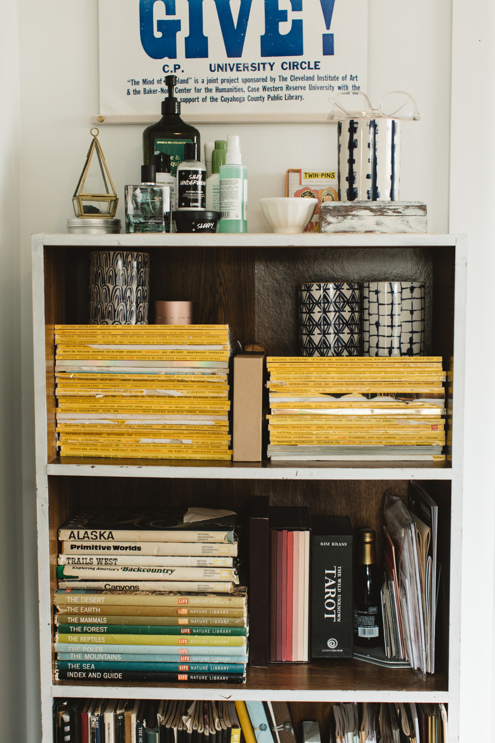 Bookshelf with old magazines and books