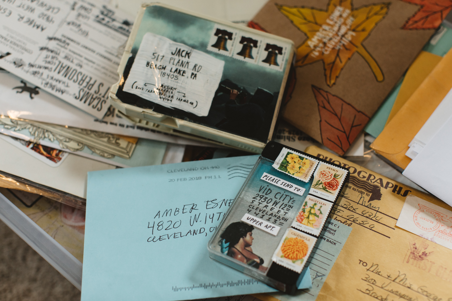 A pile of snail mail with creative drawings and collages