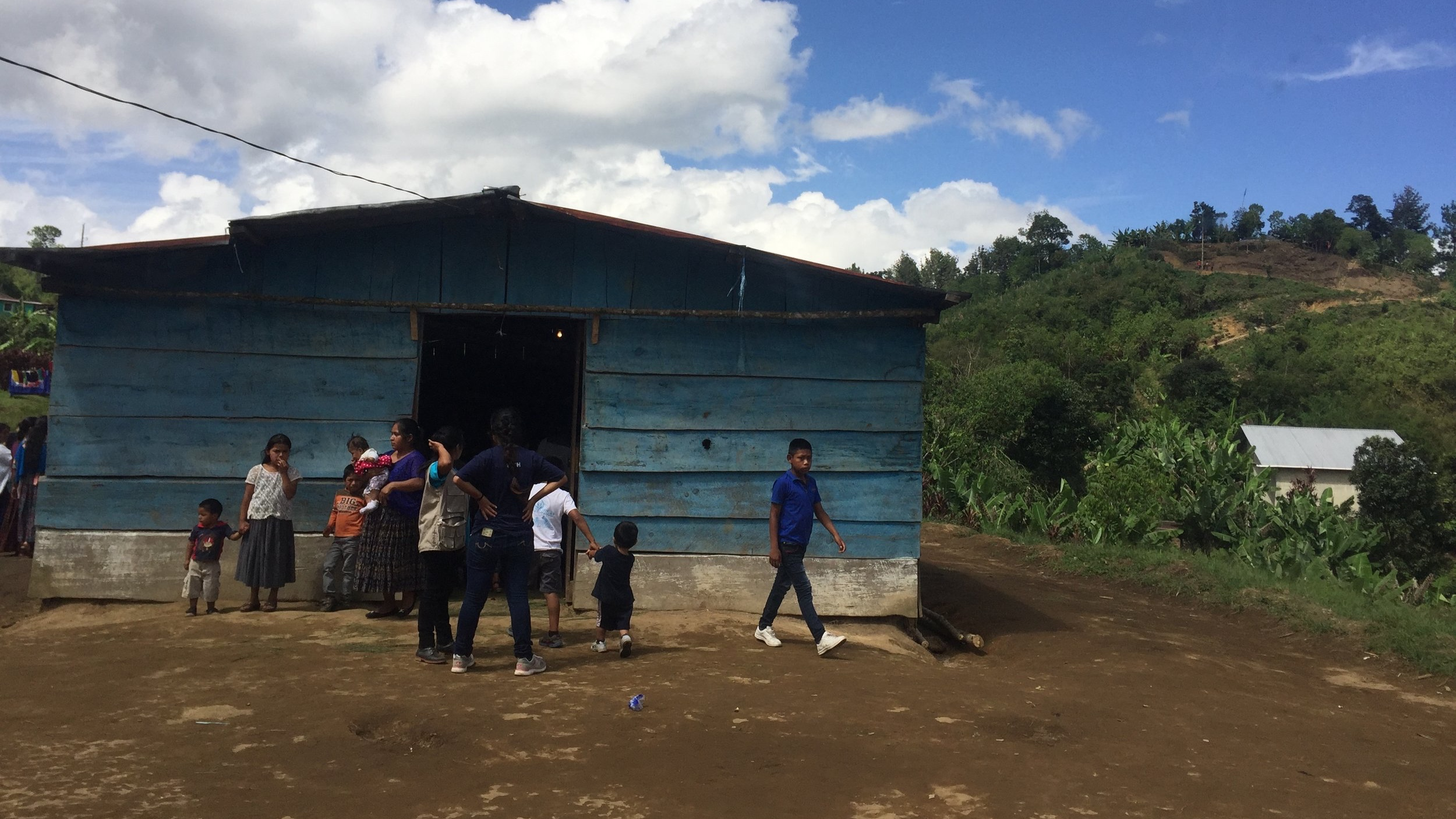 The outside of the current community center in Sesibche. The health center will have a concrete foundation and stone sides.