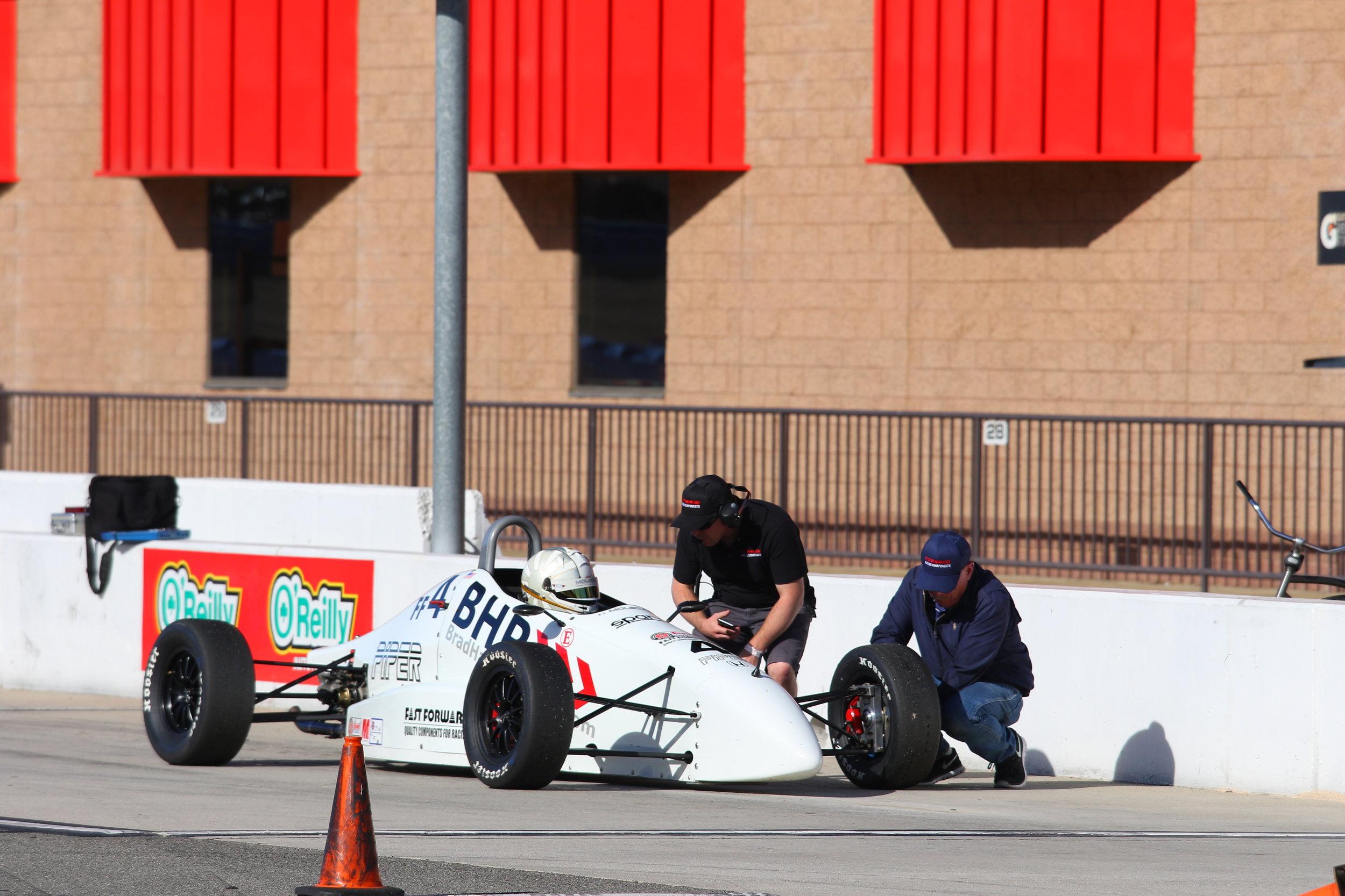 Doug Sr and Doug Jr attend to Nicky's car on pit lane