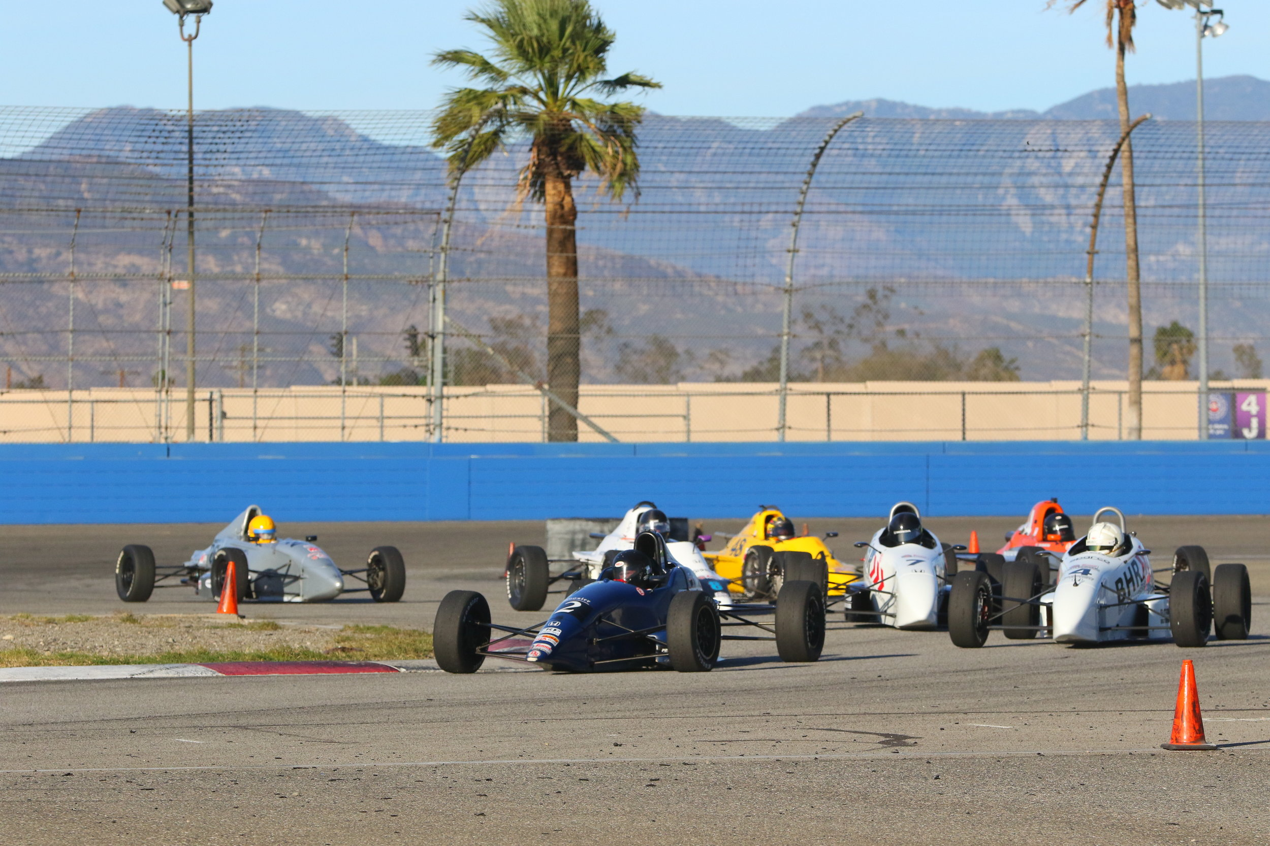 A busy turn 3-4 at the start of Saturday's race
