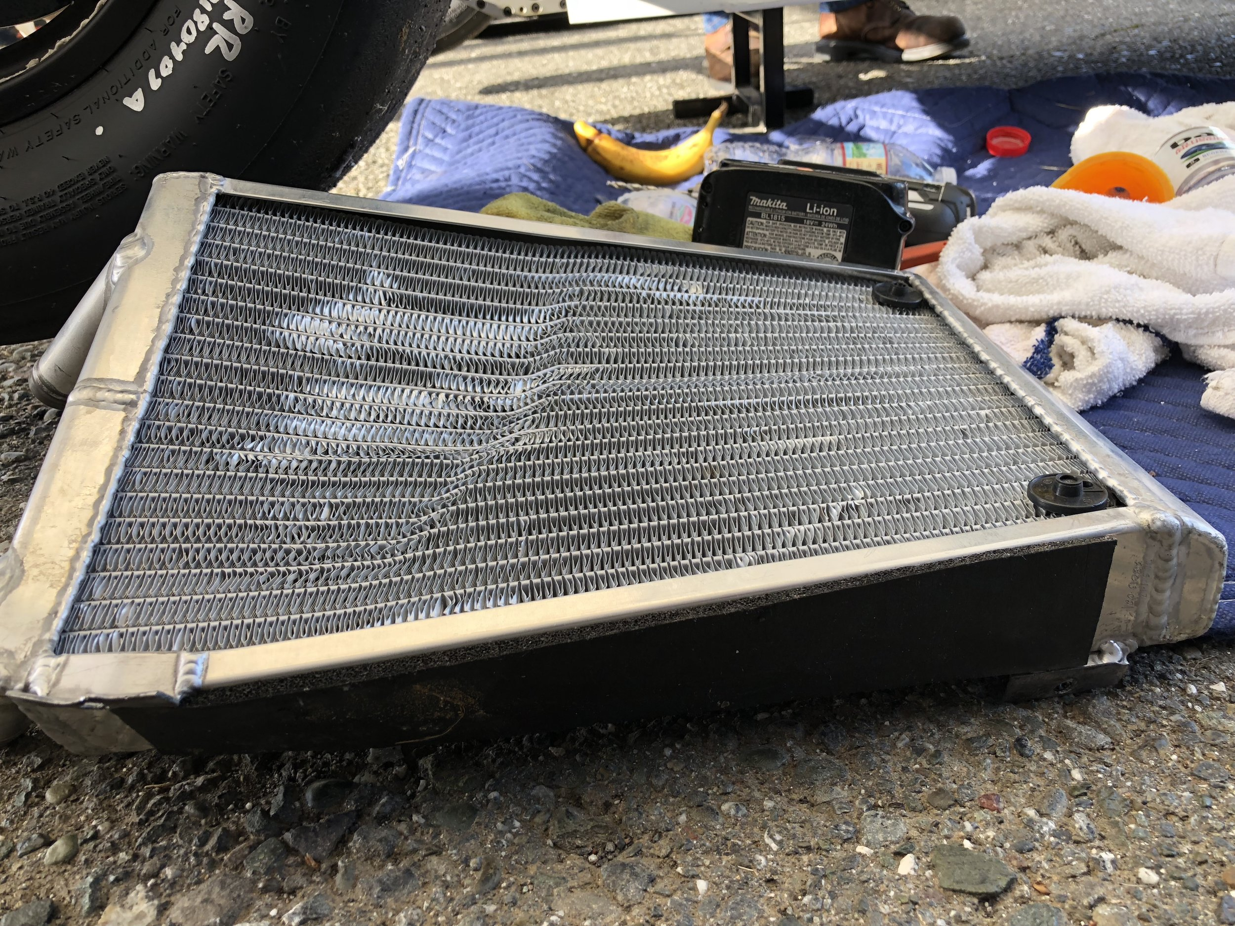 The mangled radiator from Nicky's #4 car after significant contact....luckily it still held water for the remainder of the race 1.