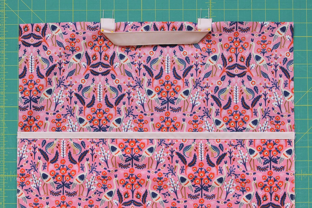 """Without twisting the fabric, rpeat on the other side, then sew 1/4"""" seam allowance on each side."""