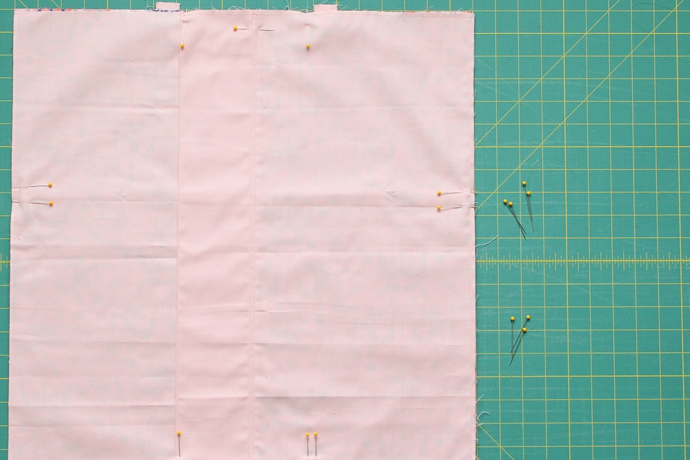 """Pin to secure and sew a 1/2"""" seam allowance around the perimeter."""