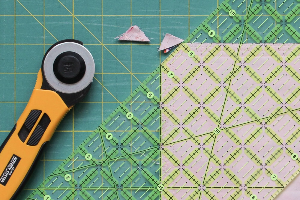 Trim the corners (do not cut through your seam) and add a zigzag stitch to prevent fraying.