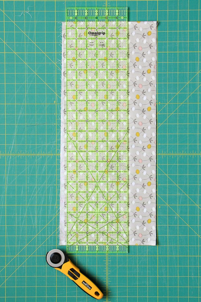 Image 3: Trim one side of your fabric to create a straight edge, thereby 'squaring up' your fabric before cutting your binding strips.