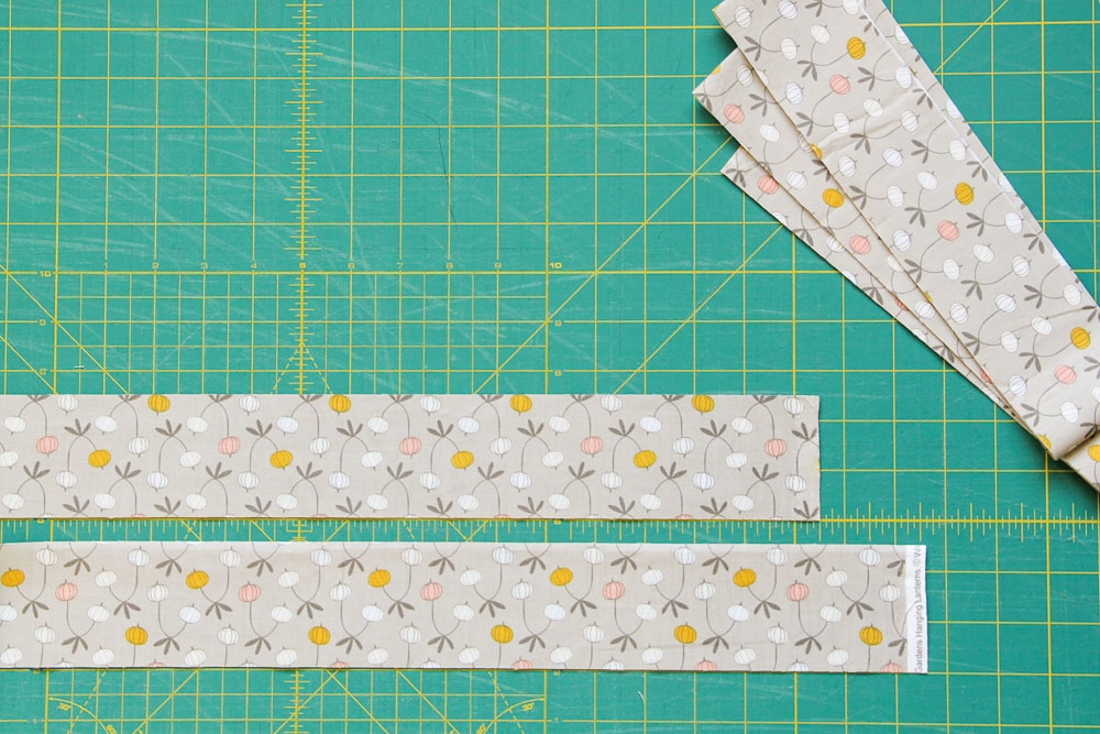 Step 1: See how the strips are oriented in opposite directions? The three leaves of the design are pointing up in the top strip and are pointing down in the bottom strip (head-to-toe).