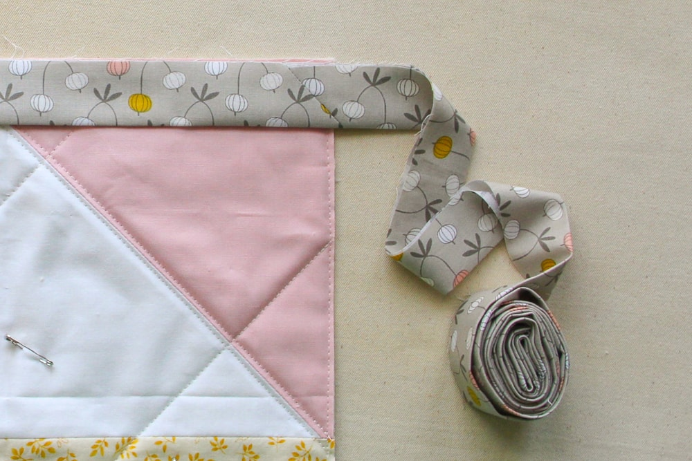 Avoid this - rework the binding layout before sewing to eliminate having seams near corners.