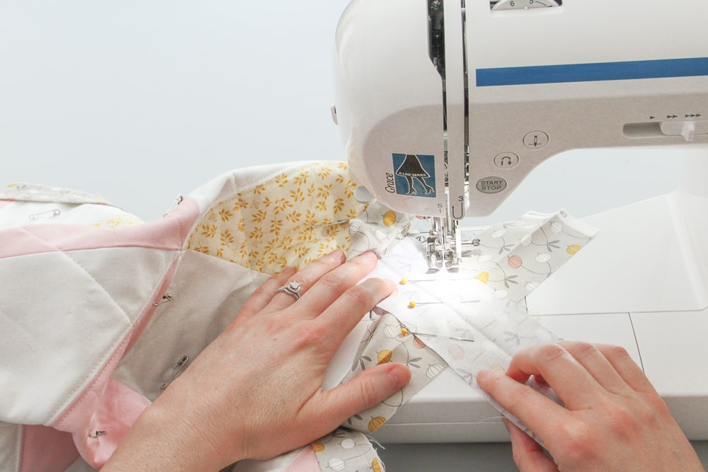4. Sew a straight line through the center, separating the attached binding from the tails.